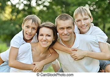Family in summer park