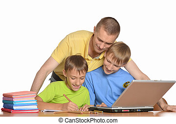 Father is helping kids with homework - Father is helping his...