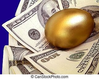 """Nest egg - Hundred dollar bills cuddle a golden \""""nest egg\"""""""