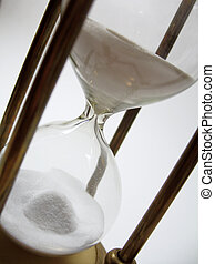 close up of hourglass - Time runs out on an antique brass...