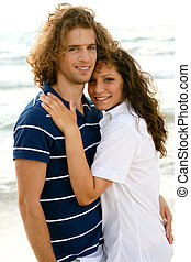 Romantic couple posing together on the beach