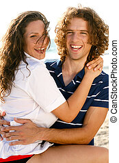 Loving couple having fun - Man and woman smiling and...
