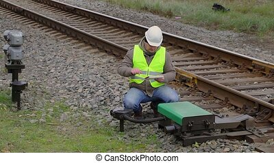 Railway engineer with tablet PC