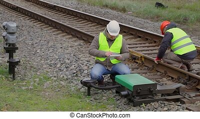 Two railway employees performing