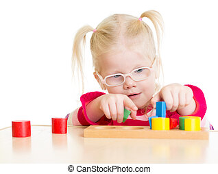 Child in eyeglases playing logical game isolated on white