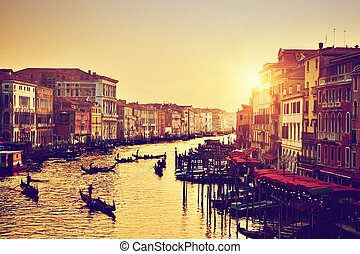 Venice, Italy. Gondolas on Grand Canal at gold sunset....