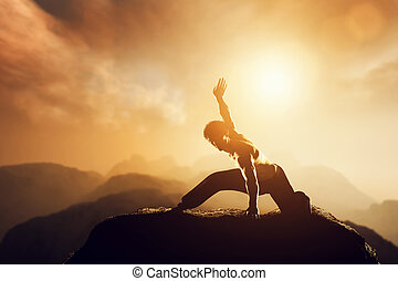 Asian man, fighter practices martial arts in high mountains at sunset.