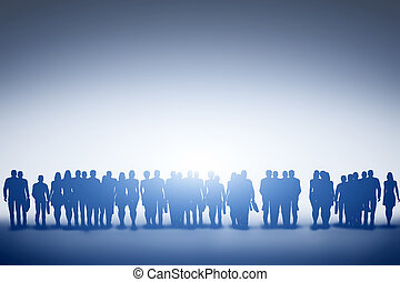 Group of business people silhouettes looking towards light...