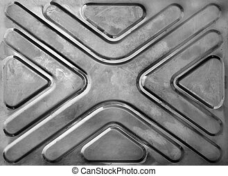 steel textural surface with symmetric geometrical drawing