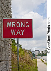 Wrong Way - A wrong way road sign on the side of the road