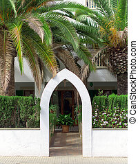 Entrance into the courtyard with palm trees