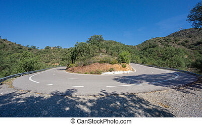 Worms eye view of hairpin bend curved road, ultra wide -...