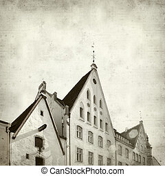 textured old paper background with Tallinn architecture