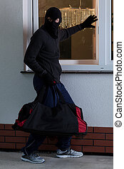 Man before professional theft - Vertical view of man before...