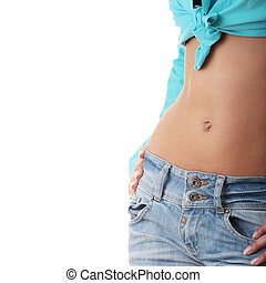 Sexy, fit woman in jeans, with naked stomach isolated on...