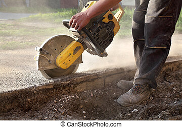 Construction site, worker cut asphalt with saw blade toll -...