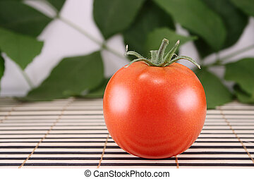 Tomato on a wooden napkin