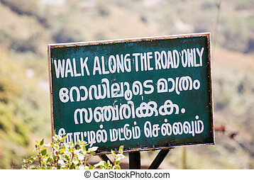 Walk along the road only