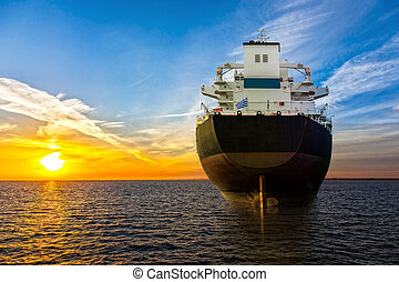Ship and sunrise - Big ship view from the stern at sea.
