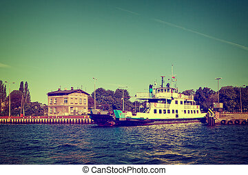 Vintage ferry boat - Car ferry boat is moored in port....