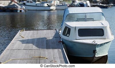 Motorboat moored at the pier - Fishing Boat at the pier...