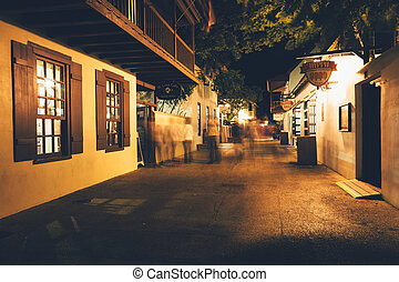 Saint George Street at night in St. Augustine, Florida. -...