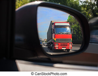 truck reflection in a car mirror - red truck reflection in a...
