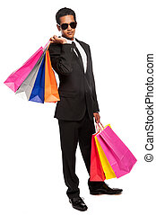 Cool Dude Young Man Shopping - Mixed race teenager carrying...