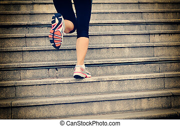 woman legs running on stairs - sports woman legs running up...