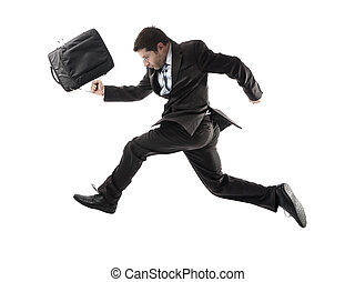young attractive businessman running late to work in stress...