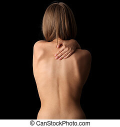 Pain concept - Woman from behind, naked body, pain concept