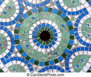 Circular Mosaic - A stone table is decorated with a circular...