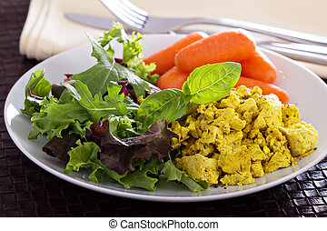 Scrambled tofu with salad leaves for breakfast - Scrambled...