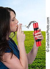Woman smoker - Beautiful woman lighting a cigarette with...