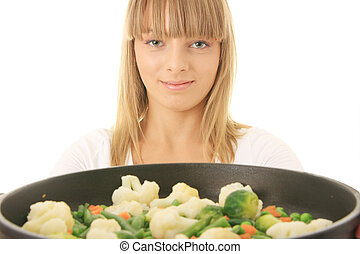 Young woman cooking food - Image of a young woman cooking...