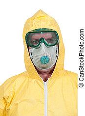 Hazmat Suit - Man wearing a hazmat suit in the face of...