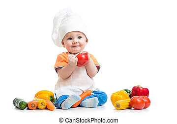 Baby wearing a chef hat with vegetables