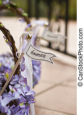 Hooray sign on a wedding basket with purple flowers