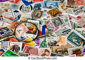Vintage Stamps - Old magnifying glass on vintage stamps.