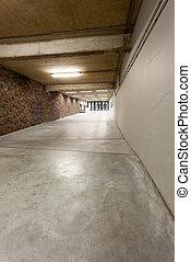 corridor - an long corridor in large building with cascading...