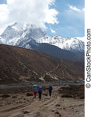 Trekkers at Everest trail, Himalaya, Nepal - Vertical...