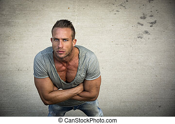 Handsome blond muscular man shot from above, looking up -...