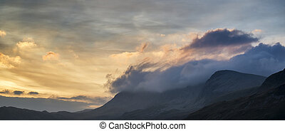 Stunning sunrise mountain landscape with vibrant colors and...