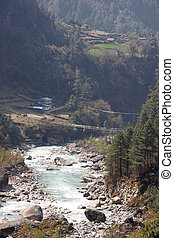 Suspension bridge across Dudh Kosi river, Nepal - Suspension...