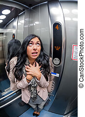 woman with claustrophobia in elevator