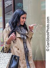 while shopping woman - a young woman einkausbummel shopping...