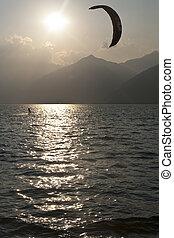 Kitesurfing - Kite at sunset on the Como lake - italy