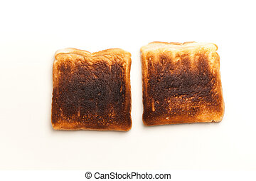 Two burnt slices of toasted bread - Two slices of bread,...