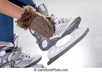 Putting on ice skates - Close-up of putting on ice skates,...