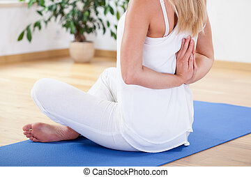 Woman preventing back pain - Woman training on exercise mat...